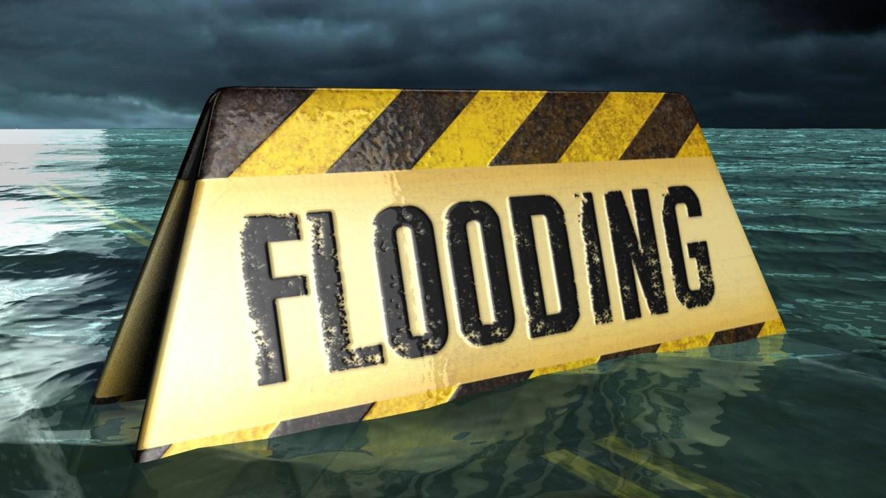 flooding warning sign_1451409704166.jpg
