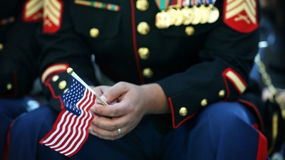 U-S--marine-holding-American-flag--Veterans-Day_20151111202312-159532