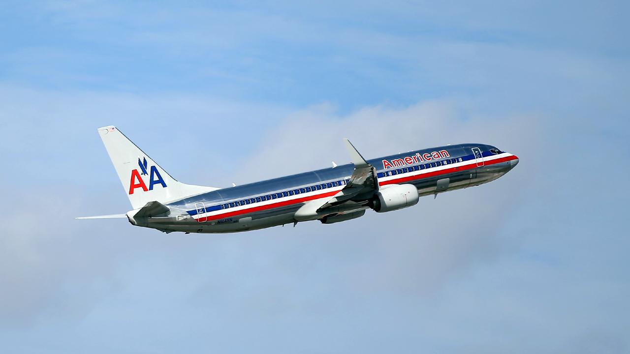 American Airlines plane flying-159532.jpg90094599