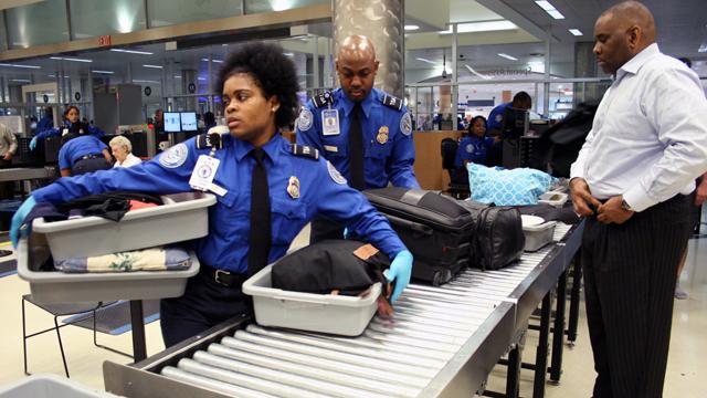 TSA checking carry ons_1490997233759-159532.jpg02967635