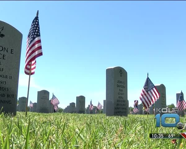Placing Flags on Graves for Memorial Day