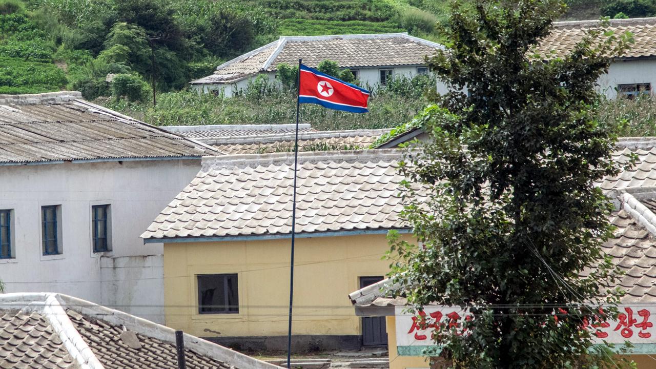 North Korea flag flies in a village-159532.jpg29979389