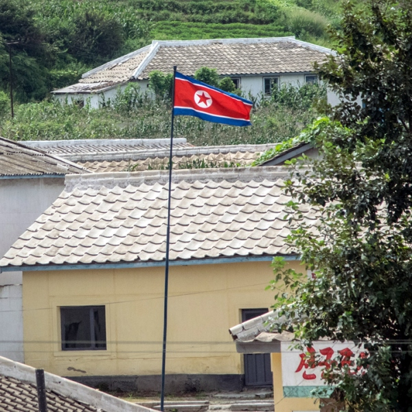 North Korea flag flies in a village-159532.jpg29979389