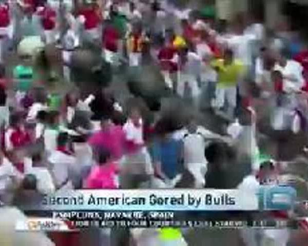 American Gored During Spain-s Running of the Bulls_05599720