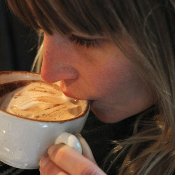 woman drinking cup of cappuccino coffee12969504-159532