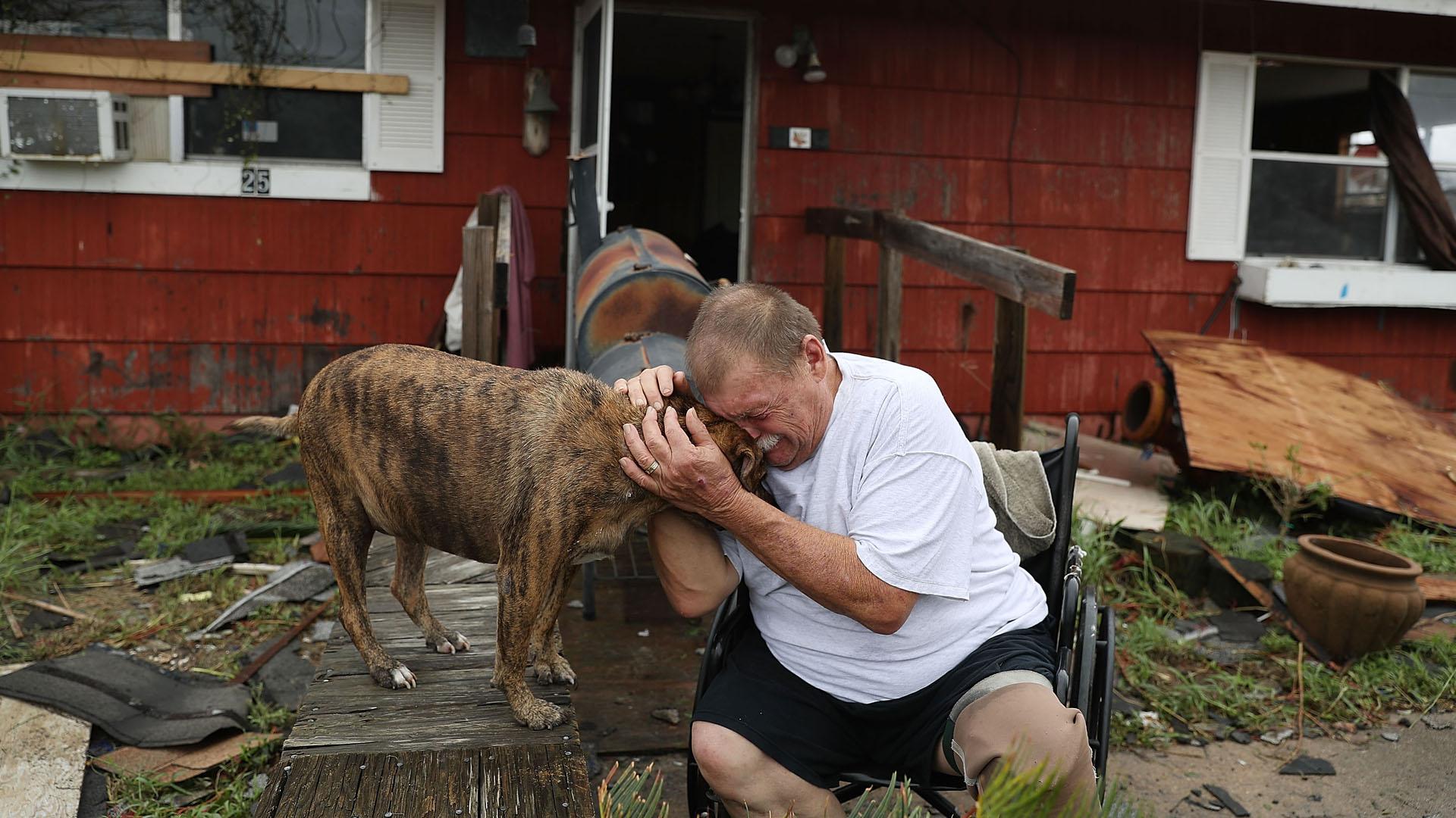 Dog, man crying in Rockport, Hurricane Harvey31096473-159532