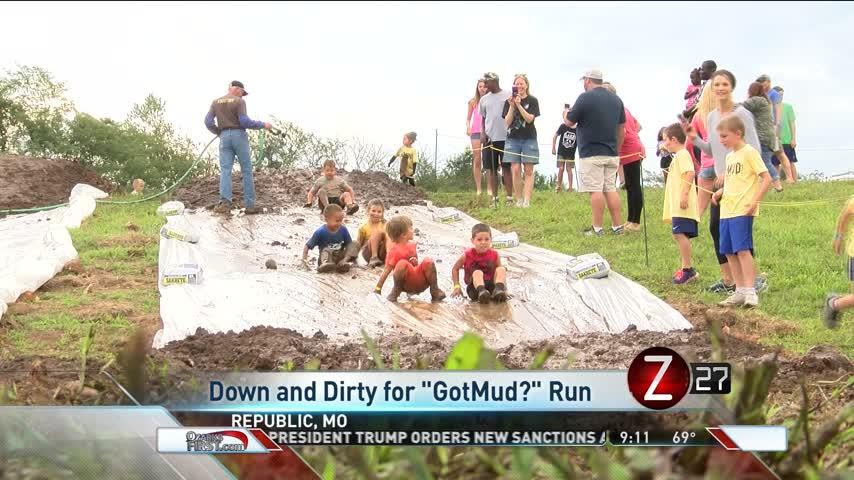 Kids Get Down and Dirty at Mud Run_45018744