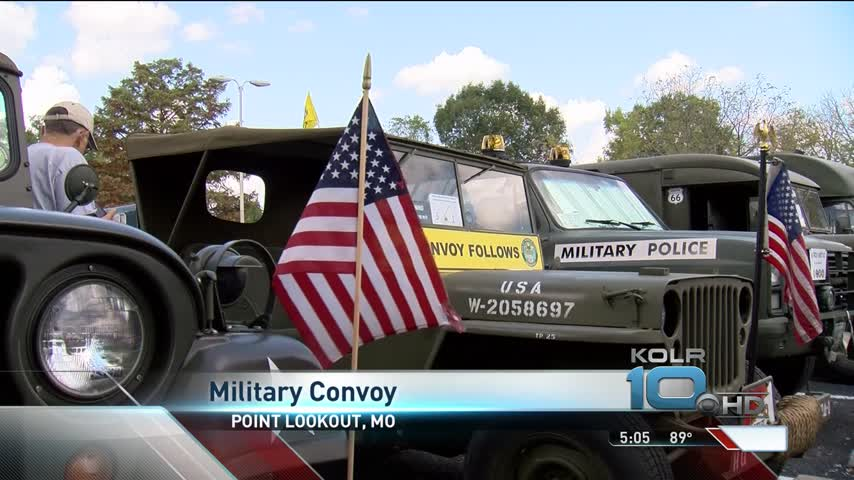Military Vehicle Convoy Passes Through Point Lookout_58159601