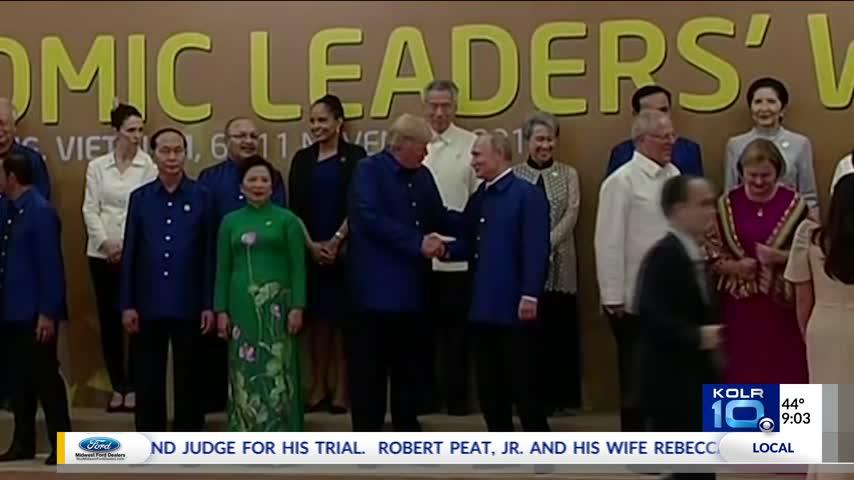Trump- Putin Shake Hands at APEC Summit_00371752