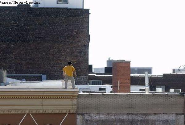 man on roof_1511222009246.JPG