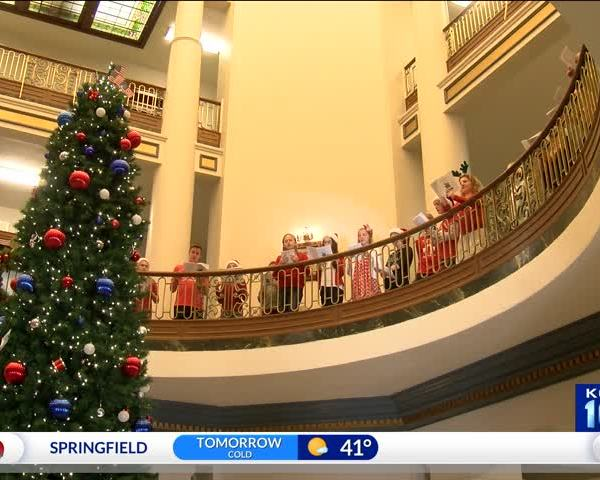 Christmas Carolers Bring Cheer to County Courthouse_92197286