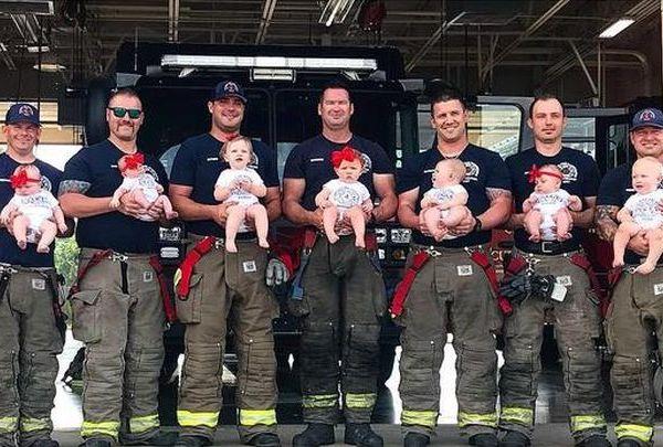firefighters w babies_1527298338135.jpg.jpg