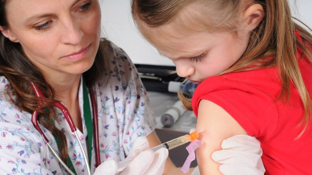 Girl getting vaccination from doctor_19487256421729-159532