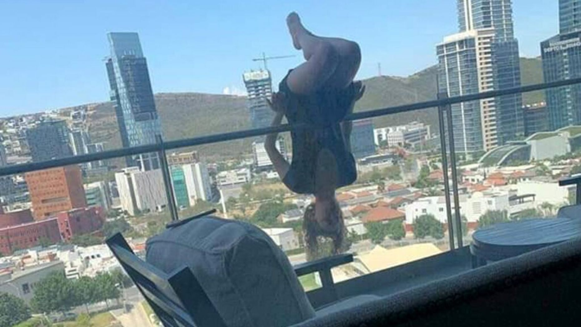Woman Falls Off Balcony While Practicing Extreme Yoga