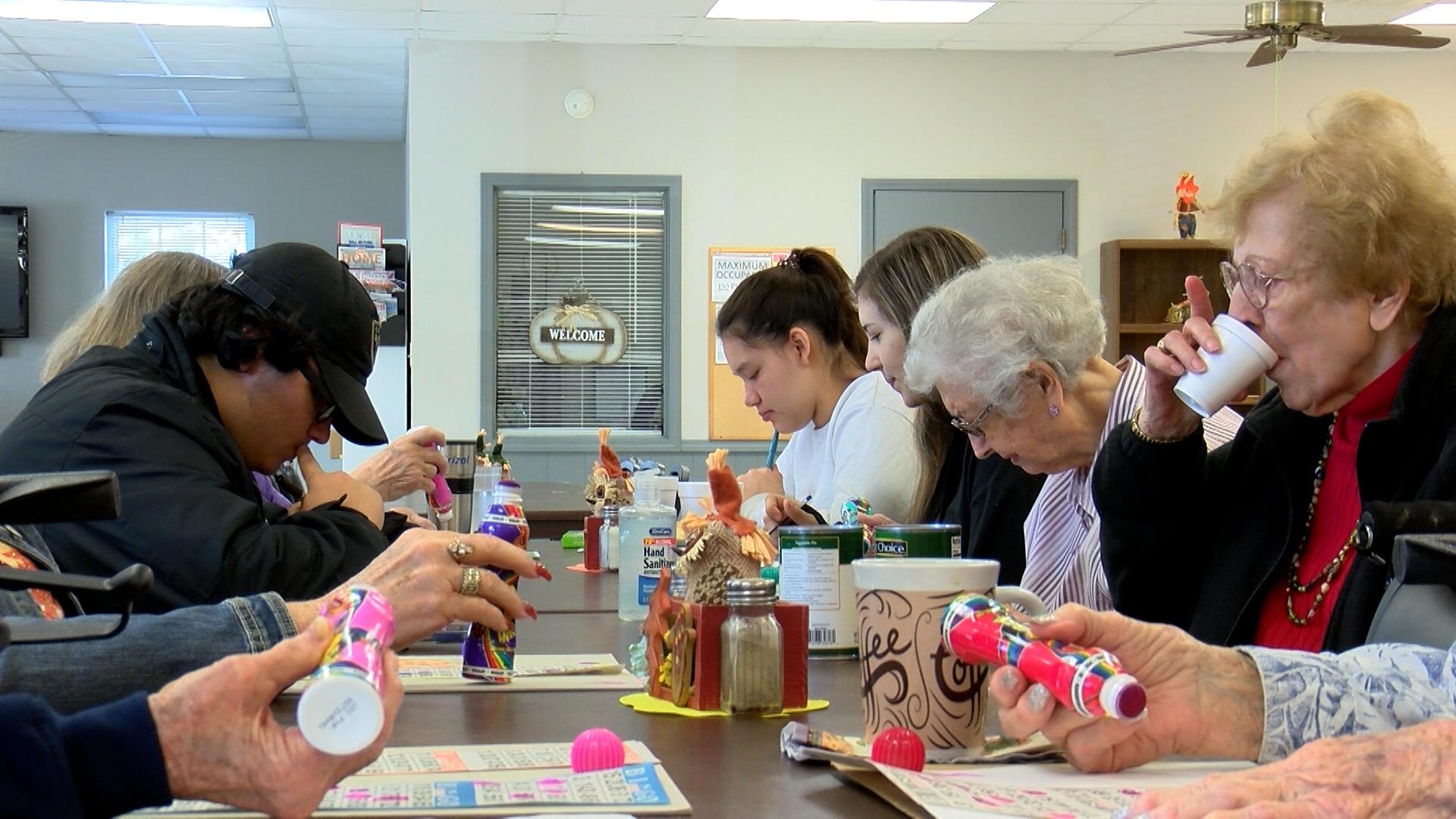 Nixa S.C.O.R.E. students pay weekly visits to Nixa senior center